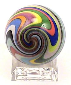 """American Signed Glass Marbles for Sale """"Monkey"""" 1.5 inch Diameter By Artist Fritz Lauenstein.Every marble collector needs to have a Fritz hand blown marble in their collection. Each one is unique and beautifully created.This marble is 1 1/2"""" in diameter and comes with a small clear acrylic base. Made in the USA by Fritz Art Glass Studios."""