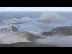 Powerful waves crash over Whitehaven's harbour wall