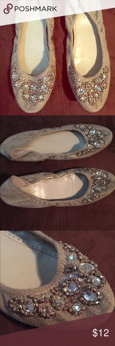 Adrienne Vittadini Jeweled Flats Such a cute and fancy pair of flats for a night out! They have jewels on the front toe and made of a canvas like material, a tan/cream color. There is some wear and tear on the bottoms but nothing extensive. Great condition! Adrienne Vittadini Shoes Flats & Loafers