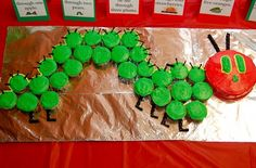 Cupcakes - themed from the book The Hungry Caterpillar. Cute idea for a kids birthday party.