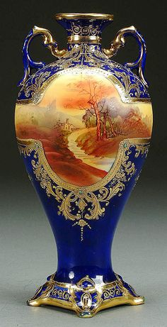 A NIPPON COBALT JEWELED AND SCENIC DECORATED PORCELAIN VASE CIRCA 1910  WITH HNAD PAINTED AUTUMNAL COUNTRYSIDE SCENE