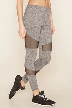 A pair of marled knit leggings with contrast mesh panels, moisture management, and a hidden key pocket. #f21active