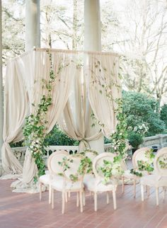 A simple yet elegant draped chuppah style ceremony presentation. The monochromatic decor accented perfectly with the greenery is complimentary to the outdoor setting.
