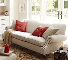 Brooklyn Sofa #potterybarn; love the styling, can be done in everyday suede.  might look the best, but not quite as practical as a sofa with removable cushions on back.