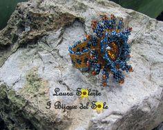 Anello Nymphea cerulea topaz&blue : il particolare della fascetta