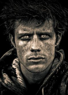Love the tone, saturation, contrast and the detail of the freckles. Man, male, face, portrait, intensity, intense eyes, I wonder what he have been experiencing - first thought a soldier returned home from war - his eyes are telling stories. Face, stunning, photograph, photo,