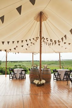 love how the sperry tents look with our wine barrels!