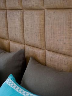 From HGTV's 2012 Green Home- a series of raffia-upholstered squares stands in place of a traditional headboard- just wrap the squares, attach them to each other and mount directly on the wall