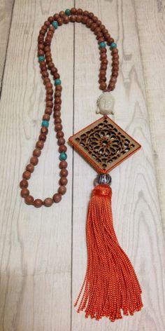 Handmade Boho Moroccan orange silk tassel pendant with filigree wood cut out ornament, wood beads, Buddha bead, turquoise beads