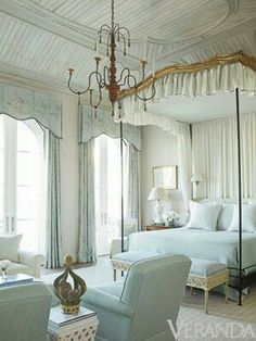 Pale blue bedroom suite with canopy bed, chairs, chandelier