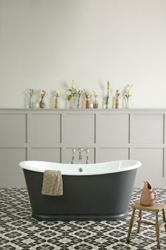 Farrow & Ball's 'Downpipe' is one of my favourite colours looks fabulous with bright colours and here with soft dusky tearose pinks.  Tiles designed by Ann Louise Roswald for the Cast Iron Bath Company