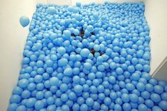 First created in 1998 with white balloons and then redone many times over, Half the Air in a Given Space is an interactive installation, by British artist Martin Creed, that's comprised of hundreds or thousands of balloons of the same color. As the name suggests, half a room's entire volume is filled with air-inflated balloons and then visitors are encouraged to walk through.