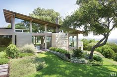 On a hill overlooking downtown Austin, Lake Flato Architects and designer Terry Hunziker collaborated on an airy minimalist retreat inventively anchored to its magnificent site.