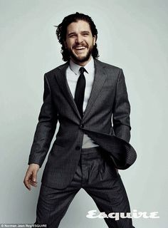 He's got a lot to smile about: Kit Harrington revealed in the June/July issue of Esquire magazine that he's moved in with his girlfriend Rose Leslie