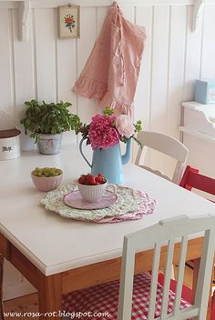 white cottage kitchen; red chair; blue coffee pot with peonies!