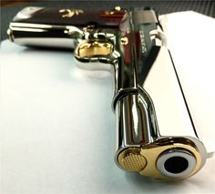 Colt 1911 A Government Model that was hand polished then nickel plated, and finally having it's minor accent parts gold plated. Not a factory offered limited edition variant, but instead of being chambered in the classic .45 ACP, the one in the photos is a .38 Super. The caliber is mostly se Find our speedloader now!  http://www.amazon.com/shops/raeind