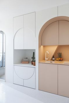 Kitchen Interior Design Built-in drop leaf table in arched Parisian apartment. - And psst! You can rent it Micro Apartment, Small Apartment Design, Small Room Design, Apartment Interior Design, Interior Design Kitchen, Parisian Apartment, Studio Apartment, Studio Interior, Small Room Interior