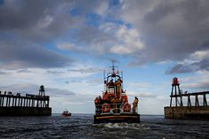 Whitby's all-weather lifeboat leads a flotilla commemorating the centenary of the SS Rohilla disaster, when RNLI boats headed to the wreck of the hospital ship off Saltwick Nab and helped to save 146 of the 229 people on board