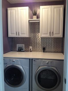 Laundry room finished product!!! Cabinets, hanging rod, folding table, and backsplash! Laundry room haven!!