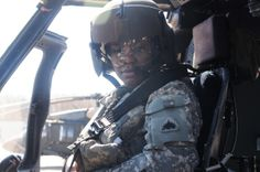 Army 1st Lt. Demetria N. Elosiebo, currently a platoon leader with D Company (Air Ambulance), 1-224th Aviation Regiment at Davison Army Airfield, Va., conducts cockpit checks in a Black Hawk helicopter on March 15, 2014. Elosiebo is the first female African-American rotary wing pilot in the D.C. Army National Guard. MELANIE AVERY/U.S. ARMY