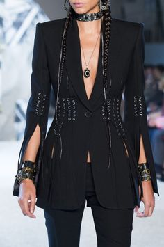 Alexander McQueen Style via Livingly.  Black, leather, edgy, blazer, waist, braids, runway, Alexander McQueen, Kendall Jenner, models, chic, sleek, silver, metallic, cuffs, choker, shoulder pads, details, Clothia, style, inspo, suit, separates, pendant, grunge