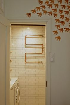 towel rack - hot water piped through copper tubing.