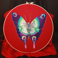 Hand embroidered mixed media butterfly using a map of Belfast