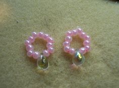 This Nipple Ring set is so easy to wear! It is made from streachy string and feels so good. Pretty Cotton Candy colored E beads with a 5x7mm Clear