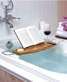 Relax in the bath with confidence, with this Aquala bathtub caddy from Umbra. Made from bamboo, this caddy will not split or mould when used over warm water. With a space for everything, including a book rest and a drink holder, this bathtub caddy is a Bathtub Caddy, Bathtub Tray, Bathtub Shelf, Bathroom Storage, Bath Trays, Bathtub Pillow, Wood Bathtub, Clawfoot Bathtub, Bath Table