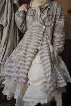 The 18th C and Viviene Westwood look of this is what appeals in this coat - be better in another fabric
