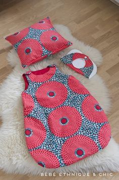Baby bib, toddler pillow, and baby sleep sack. If someone doesn't request this I'm going to sew it for my two almost-born nieces/nephews. I think my supplier has this fabric! I think this is a french designer. www.adorablyafrican.com/bespoke