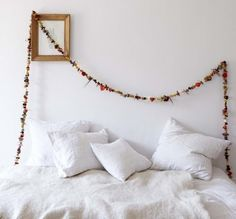 There's no need to wait for a special occasion to drape a dried flower garland around the house. The one above was spotted in Shane Power's beautiful book Bring the Outdoors In, and you can get a similar look by stringing botanicals found at DriedDecor.com and crafts supply stores.