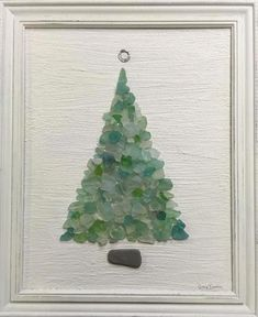 Soft turquoise beach sea glass tree on vintage canvas, set in vintage frame, painted soft creamy white. The base of tree is rectangle beach stone, topper is metal found on beach, and the tree is a col Sea Glass Crafts, Sea Glass Art, Stained Glass Art, Sea Glass Beach, Glass Art Pictures, Broken Glass Art, Crushed Glass, Theme Noel, Glass Christmas Tree