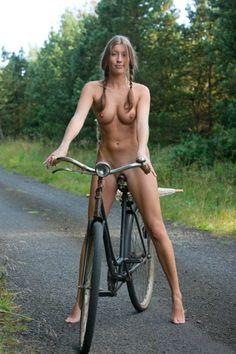 Naked girls on bikes apologise