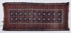 A Baluch rug early 20th century. Localised wear and holes.  from cambi casa d'este