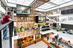 Image 1 of 24 from gallery of Building 83 Interior Architecture / Bora Architects. Photograph by Brian Smale Base Building, Building Design, Atrium Design, Corporate Interior Design, Homemade Modern, Wood Architecture, Business Architecture, Lawn Chairs, Lounge Areas