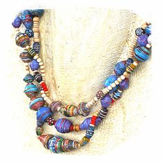 paper bead necklaces at http://www.rocksandpaperswans.etsy.com