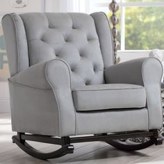 Part armchair, part rocker, all comfortable: that's the Delta Children Emma Nursery Rocking Chair in a nutshell. This rocker features classic. Upholstered Rocking Chairs, Rocking Chair Nursery, Glider And Ottoman, Glider Chair, Swivel Glider, Swivel Chair, Toddler Furniture, Children Furniture, Delta Children