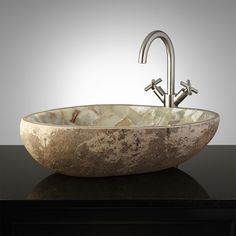 Truly a one-of-a-kind treasure, this vessel sink is handcrafted from a solid piece of natural river stone and inlaid with stunning Green onyx mosaic pieces. Add a single-hole vessel filler to complete the look. Because of its natural material, this basin Glass Sink, Vessel Sink, Sink Faucets, Bathroom Sink Design, Bathroom Sinks, Stone Bathroom, Master Bathroom, Stone Bathtub, Bathroom Green