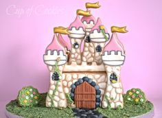 A 3D cookie castle  made by Cup of Cookies facebook.com/cupofcookies
