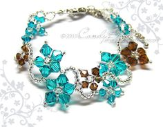 Swarovski Crystal Bracelet, Flora bracelet teal and brown with silver clasp and adjustable chain by CandyBead. $16.50, via Etsy.