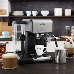 When you talk about the brand Mr. Coffee, you expect to find professional coffee machines at a reasonable price tag. Here we have Mr. Coffee Café Steam Automatic Espresso and Cappuccino Machine. It makes an economical addition to our list while possessing some excellent features for a home espresso machine. Best Home Espresso Machine, Espresso Machine Reviews, Automatic Espresso Machine, Espresso Coffee Machine, Coffee Cafe, Cappuccino Maker, Cappuccino Machine, Professional Coffee Machine, Breville Espresso