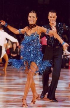 Dancing in peacock blue - latin dance sport