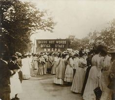 This photograph shows Suffragettes en route to Women's Sunday on the 21st June 1908. Women's Sunday was the first 'monster meeting' to be organised by the Women's Social and Political Union. Trains were chartered to bring in thousands of suffragettes from all over Britain.