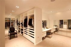 Gorgeous walk in wardrobe with large mirrors to make space look bigger | #wardrobe