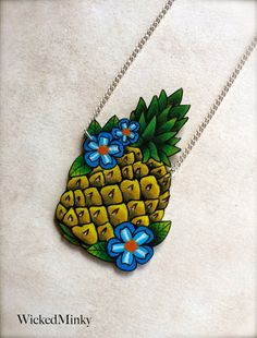 Pineapple with blue flowers tattoo necklace on by wickedminky