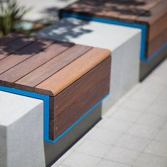 Custom bench shown with Azure texture powdercoated frame and FSC® Ipé hardwood slats at Playa Vista, Los Angeles, California