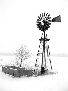 Black and White taken during the first snowstorm of the windmill on the corner of my property at the farm. Windmill Drawing, Windmill Tattoo, Farm Windmill, Old Windmills, Water Tower, Old Farm, Le Moulin, Farm Life, Black And White Photography