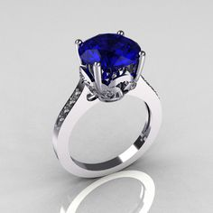 Classic 10K White Gold 3.5 Carat Blue Sapphire Pave Diamond Solitaire Wedding Ring R301-10WGDBL. $1,049.00, via Etsy.