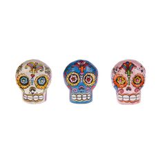 """Set of Three Drawer Knobs.Simply the loveliest knobs we've seen this season. Picking up on the latest colourful trend for the Mexican holiday """"Day of the Dead"""" sugar skulls, this set of three drawer knobs feature pink, blue and white brightly patterned knobs. A fab and funky idea for a teenager room or simply use to brighten up a tired set of drawers.Wood.Size: dia 4cm x h4.5cm."""